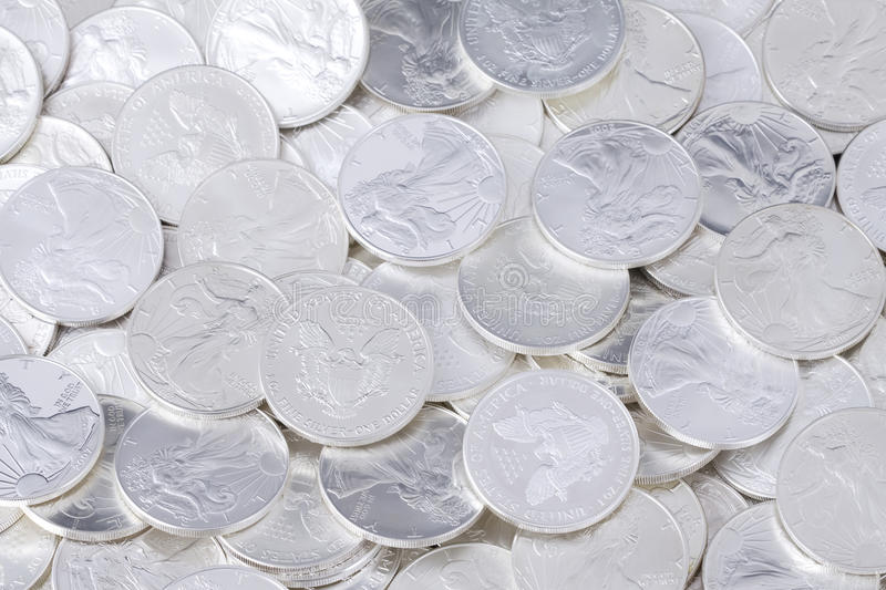 Shiny coins background. Silver shiny one dollar coins, money background royalty free stock images