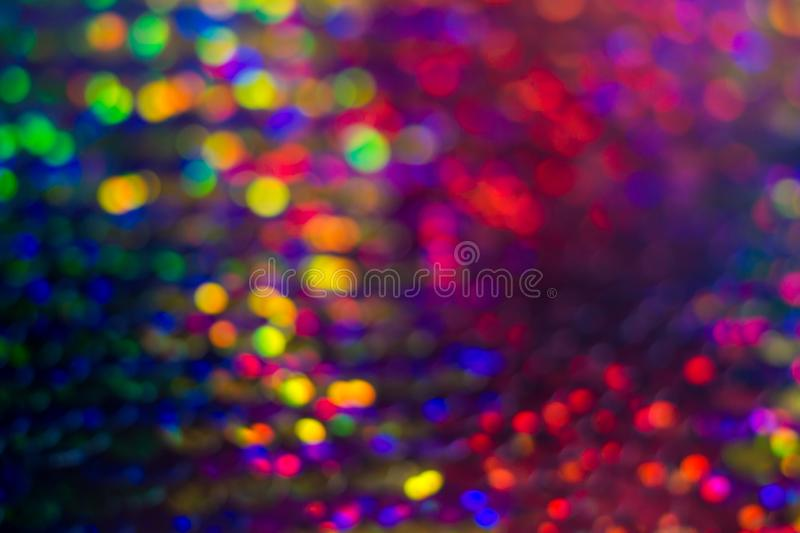 Shiny colorful sequin dress detail texture. Neon disco color royalty free stock photo