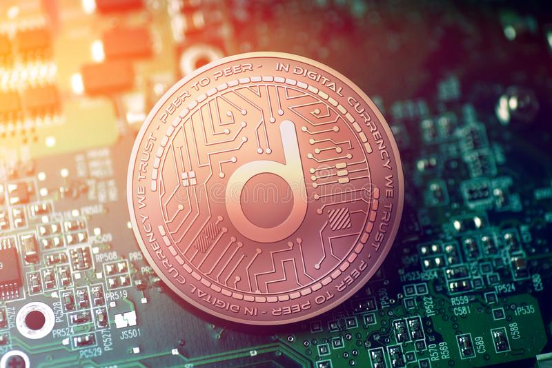 Shiny copper DATUM cryptocurrency coin on blurry motherboard background. Token stock photography