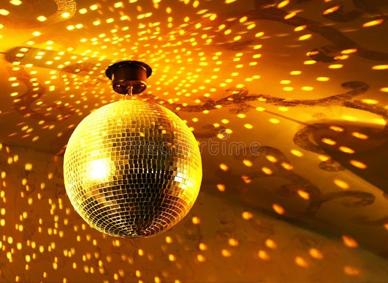 Shiny disco ball. Shiny golden disco ball on nightclub