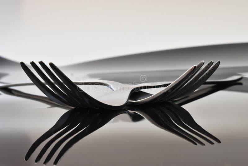 Fork on black background stock image