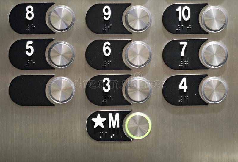 Shiny elevator buttons stock photography