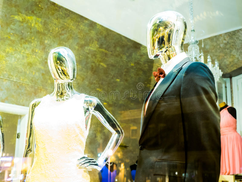 Shiny, Faceless Mannequins in Store Window royalty free stock images