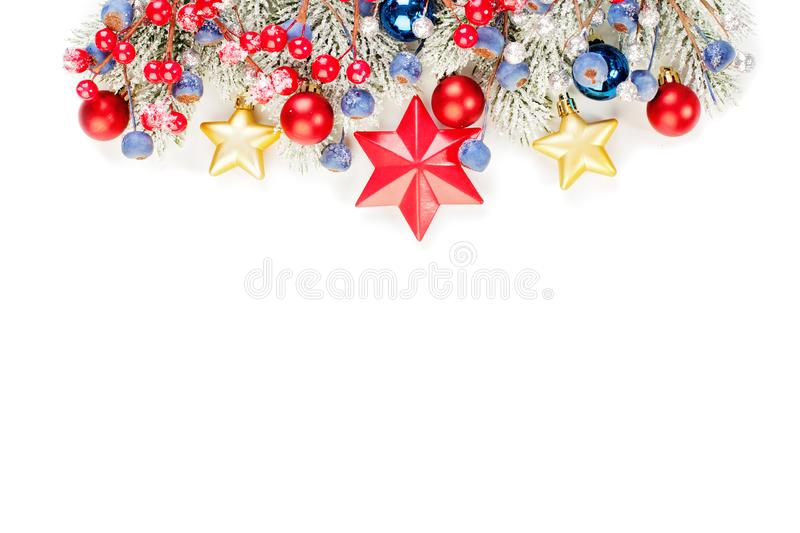 Shiny glitter Christmas border isolated on white background. Colorful banner with green Xmas tree twig, holly berries. Red and blue baubles and golden stars royalty free stock images