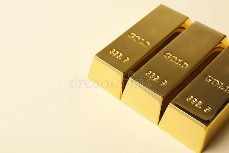 Shiny gold bars on light background. Space for text royalty free stock photos