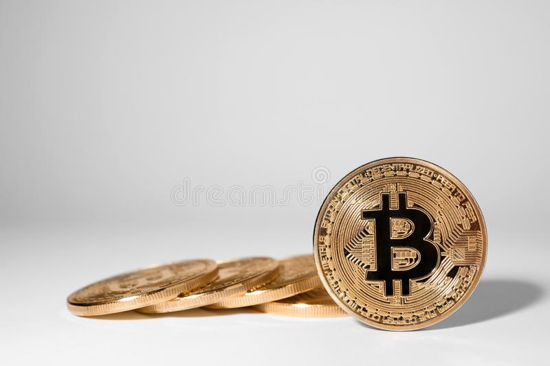Shiny gold bitcoins on light background, space for text. Digital. Currency royalty free stock photo