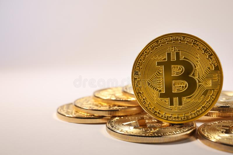 Shiny gold bitcoins on light background, space for text. Digital. Currency royalty free stock photography