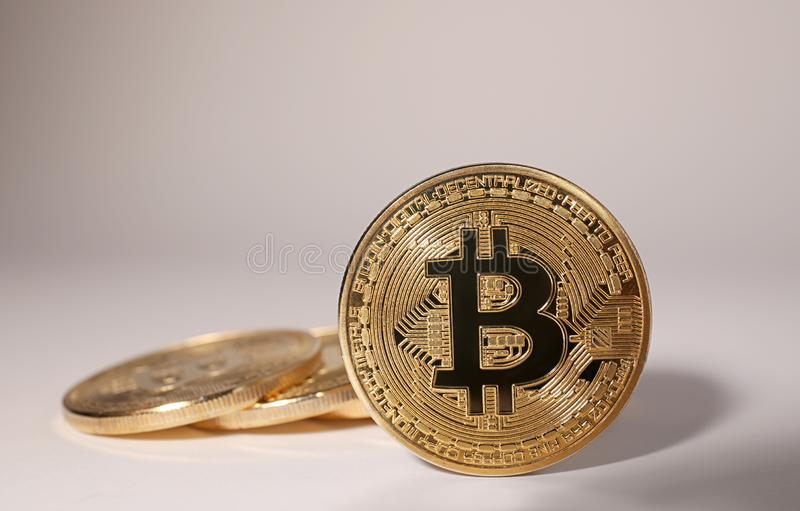 Shiny gold bitcoins on light background, space for text. Digital. Currency royalty free stock photos