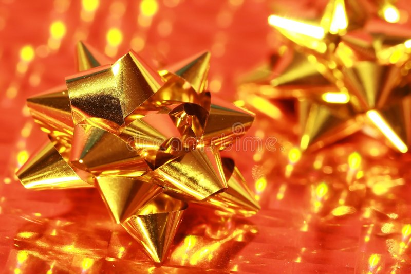 Shiny gold of gift bow on gold stock photos