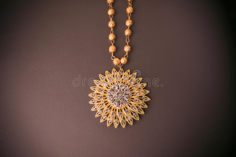 shiny gold jewelry on Brown leather. stock image