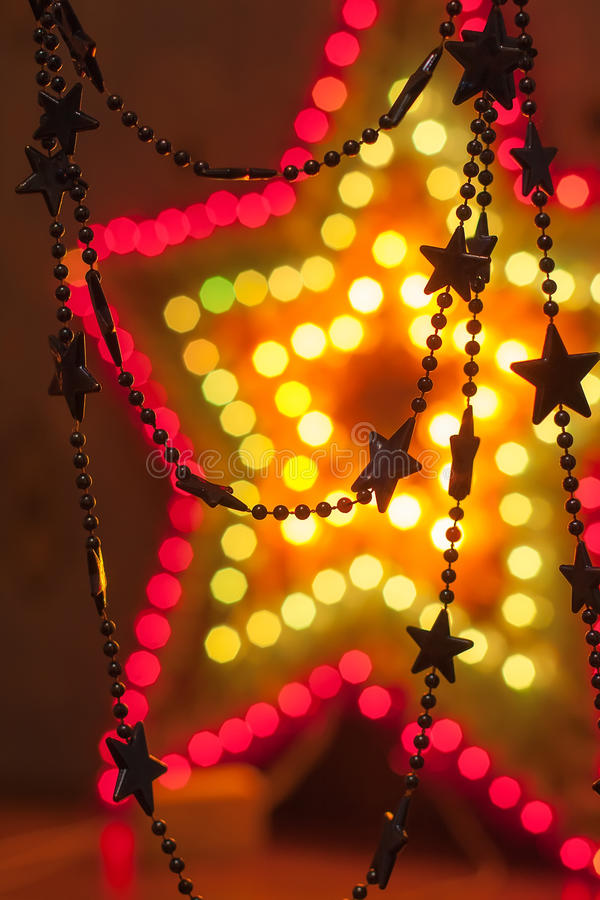 Shiny golden stars. Many small stars on a big glowing star the modern bokeh background royalty free stock images