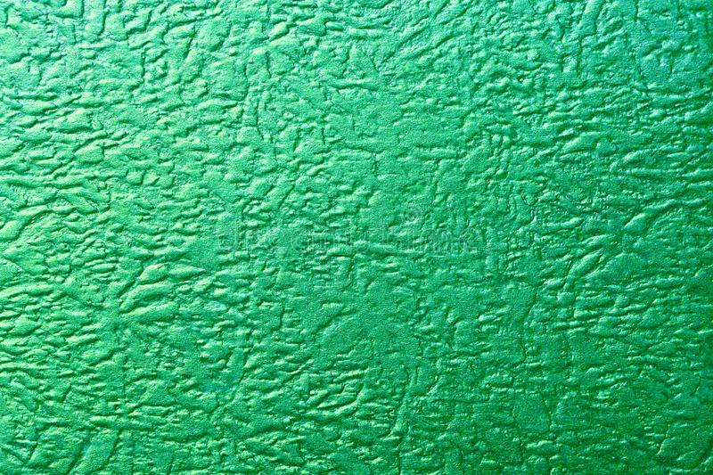 Shiny green foil texture metallic background. Foil abstract decoration royalty free stock image