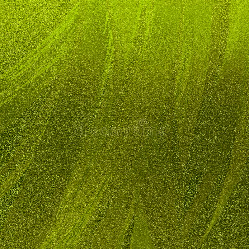 Shiny green metallic sand textured abstract background. Tinted brush strokes artwork. Glitter scattered on grungy rough surface. Sand textured abstract stock image