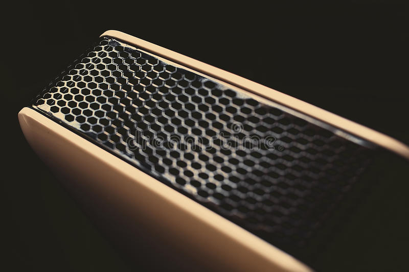 Shiny grille in dark room royalty free stock images