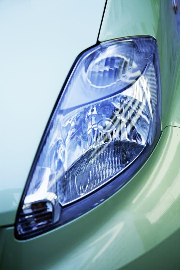 Shiny headlight of a car stock image