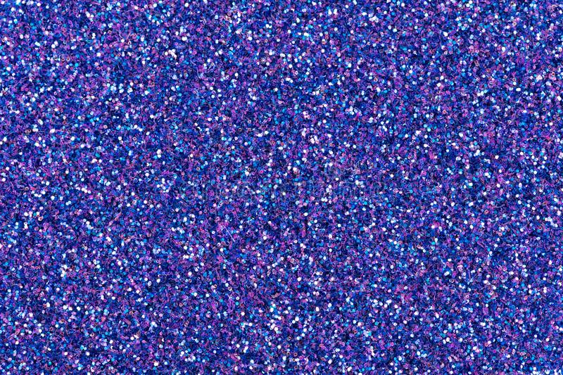 Shiny holographic glitter background, new christmas texture in awesome dark blue color. stock images