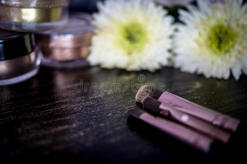 Shiny make-up accessories flowers stock photos
