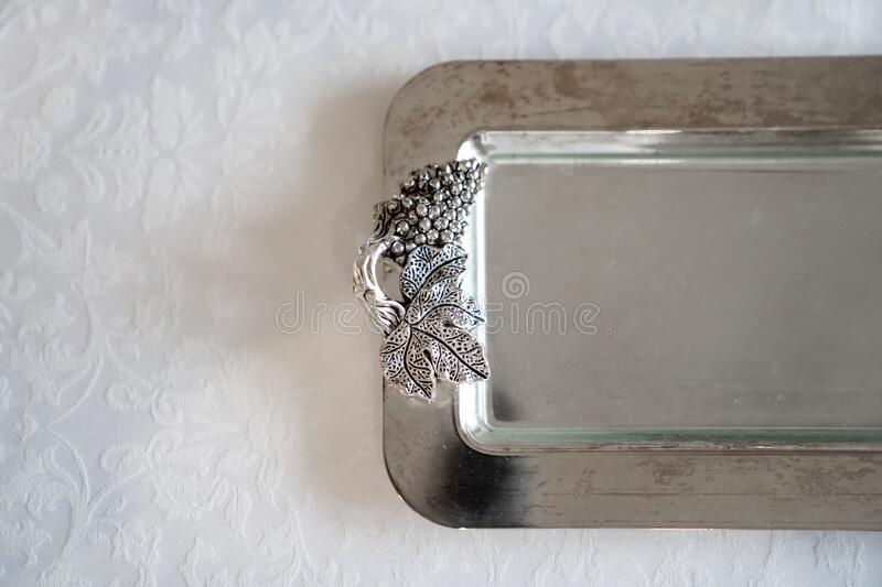 Shiny metal handout tray. the design element of the festive table. Beautiful tableware. copy space stock photo