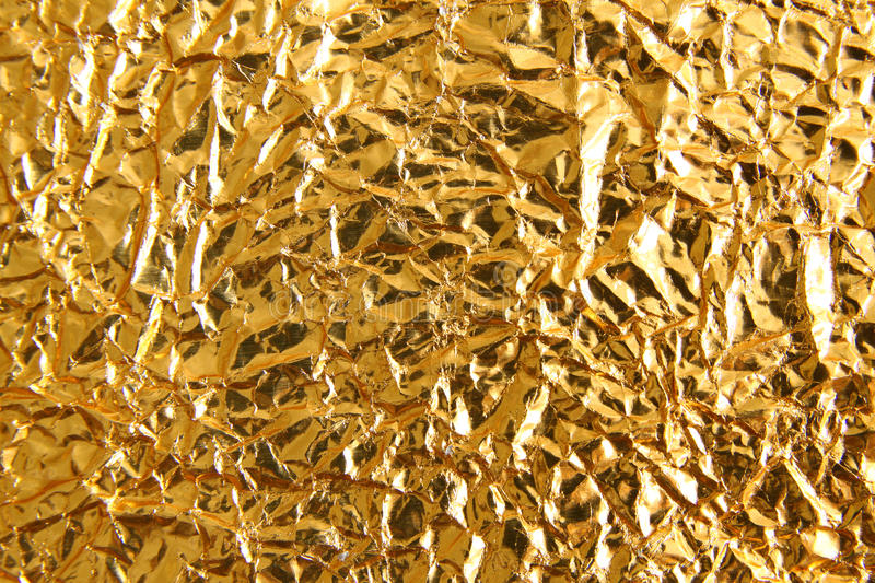 Shiny metal yellow golden texture background. Metallic gold pattern royalty free stock images