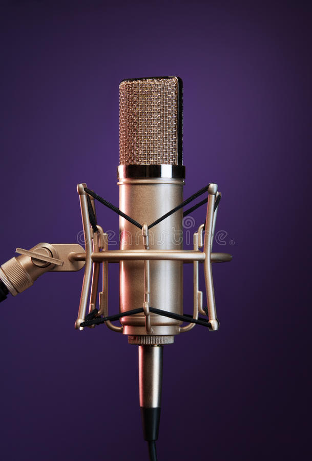 Shiny metallic mic on stand stock images