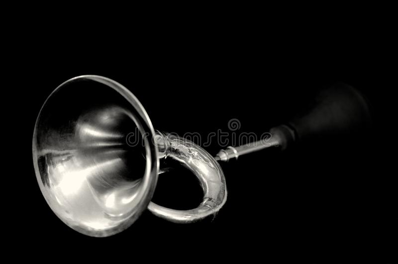 Shiny and nice signal horn in silver, in perspektiv on black background stock photo