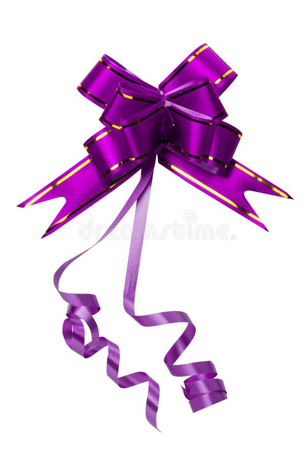 Shiny purple and gold bow isolated on white background with copy space. Ribbon for gift or present concept. Happy New year stock images