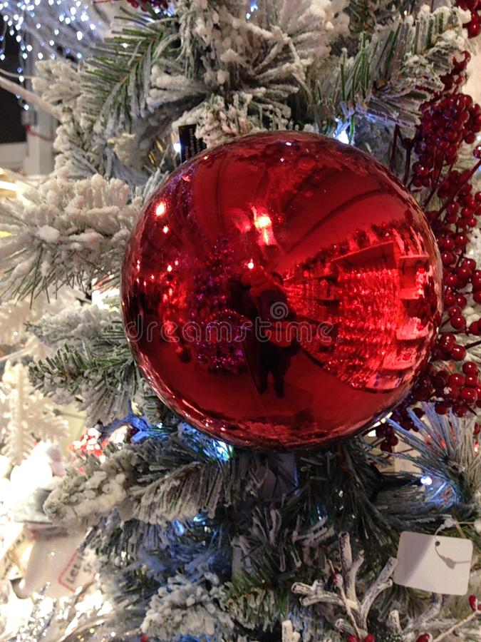 A shiny red glass Christmas bauble royalty free stock photo