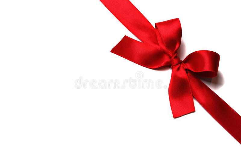Shiny red satin ribbon. With bow on white background stock images