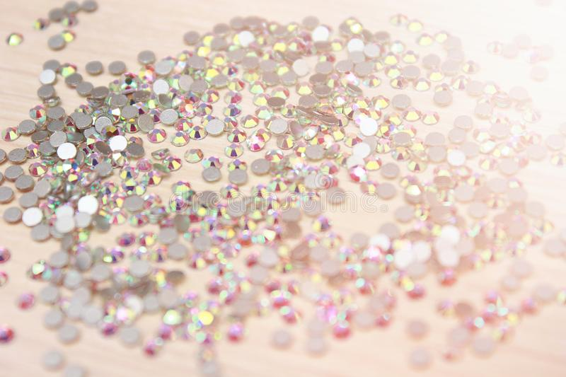 Sparkling rhinestones in the frame. Different color crystals. Handmade ideas. Shiny rhinestones background Close up of a whie all covered with shiny rhinestones royalty free stock photos