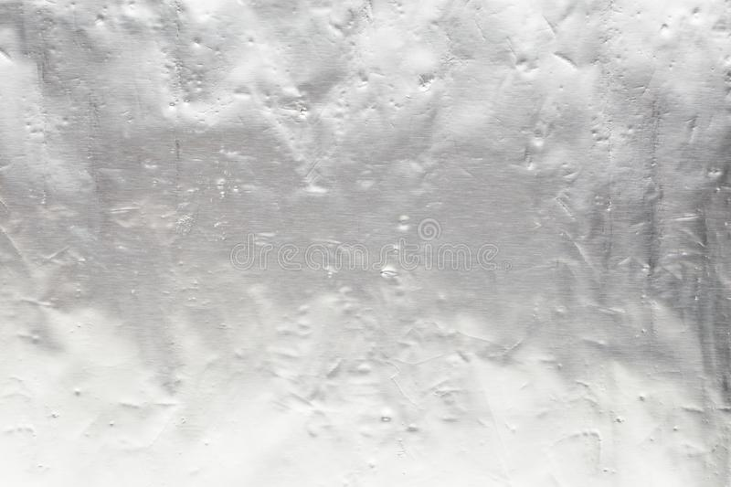 Shiny scratched silver metal texture foil background. Shiny scratched silver metal texture foil for use in design as a background royalty free stock photo