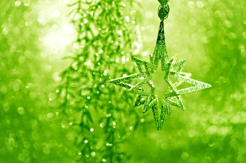 Shiny silver star with green lights stock photography