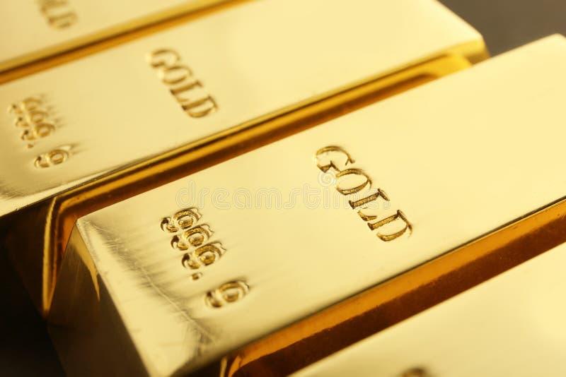 Shiny sleek gold bars as background. Closeup royalty free stock images