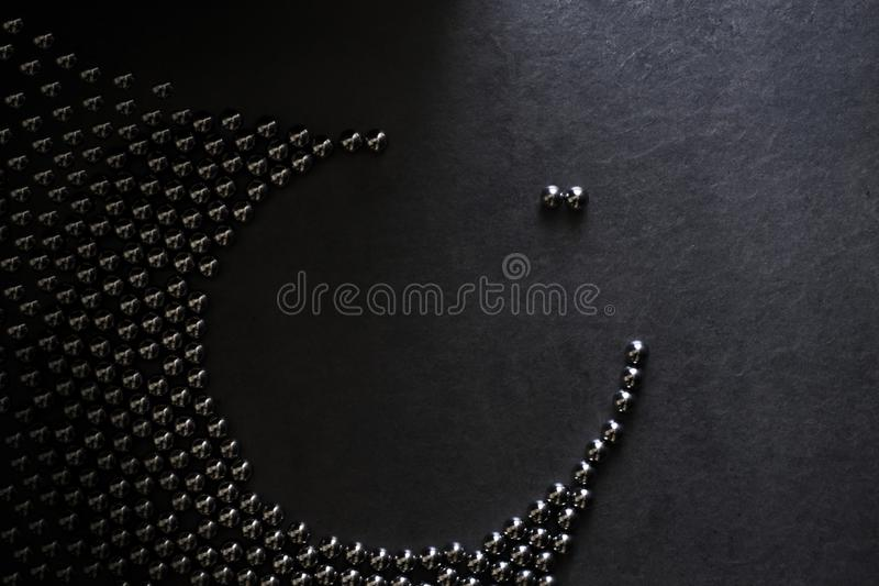 Shiny steel ball bearings in a composition. Of manhunt and pursuit of the love couple stock image