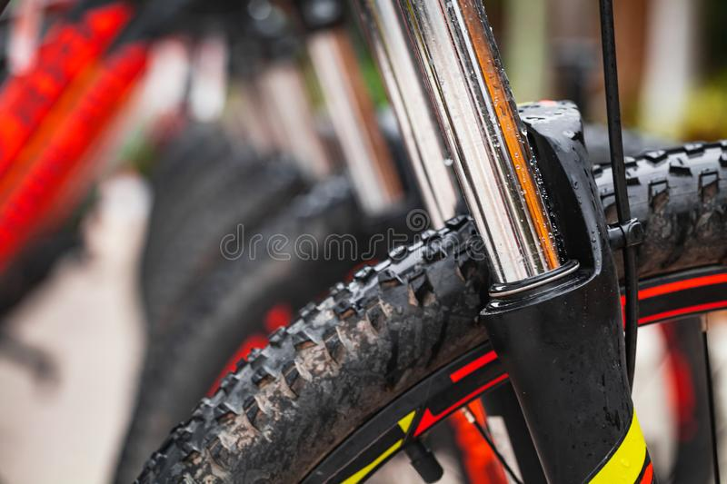 Shiny steel bicycle fork, close up. Shiny steel bicycle fork, the part of a bicycle that holds the front wheel. Mountain bike details, close up photo stock photos