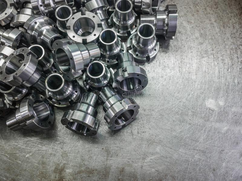Shiny steel parts after cnc turning, drilling and machining on steel surface with selective focus. royalty free stock photography
