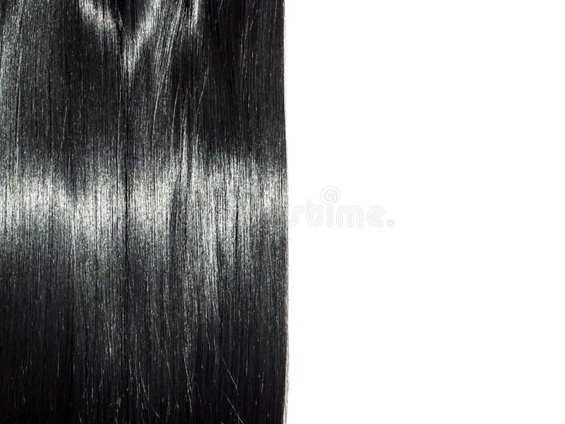 Shiny straight black hair background. Beautiful smooth brunette hair backdrop royalty free stock image