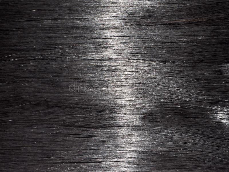 Shiny straight black hair background. Beautiful smooth brunette hair backdrop stock photography