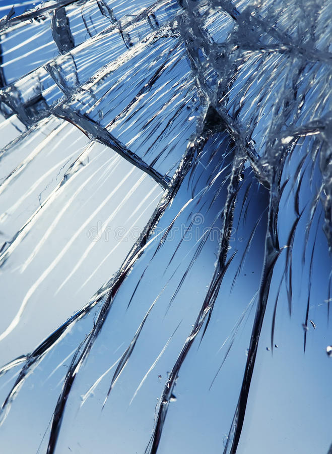 Shiny texture blue mirror surface with small and large cracks royalty free stock images