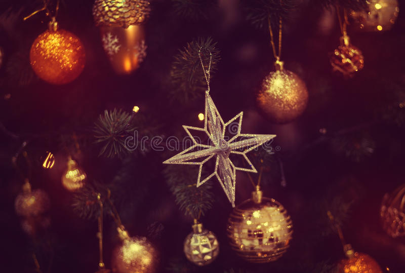 Shiny toy on the Christmas tree. Red shiny toy on the Christmas tree, fairy-tale mood stock image