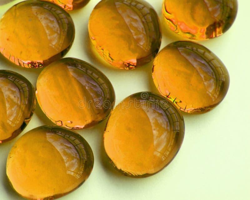 Shiny yellow glass stones royalty free stock photography