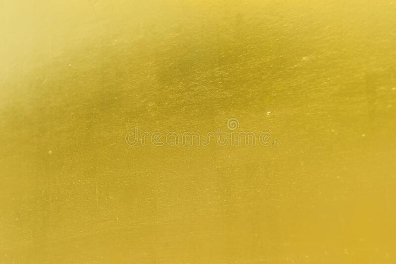 Shiny yellow gold background. Shiny yellow gold cement texture background royalty free stock image