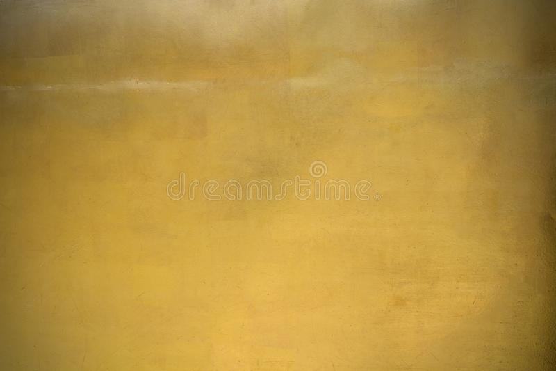 Shiny yellow leaf gold foil texture background.  stock illustration