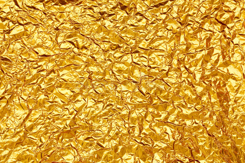 Shiny yellow leaf gold foil stock photo