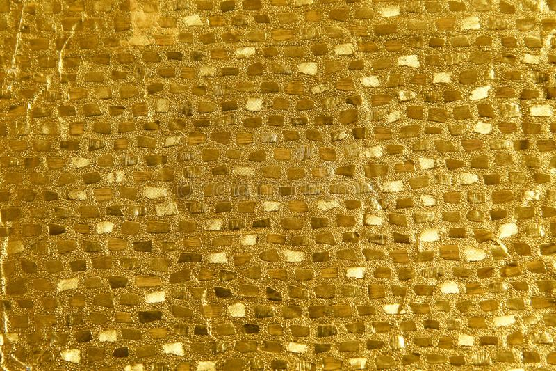 Shiny yellow leaf gold foil texture background royalty free stock photo