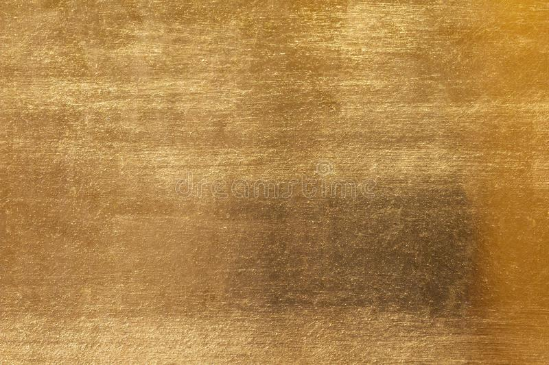 Shiny yellow leaf gold metal texture and background royalty free stock image