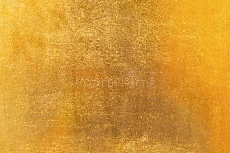 Shiny yellow leaf gold metal texture and background stock image