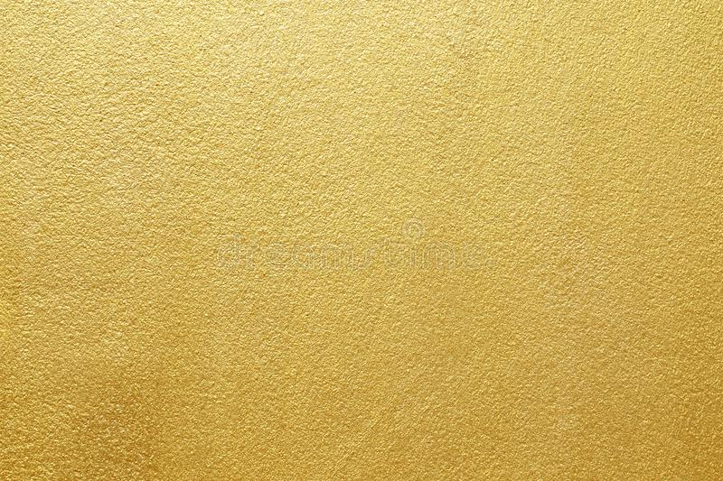 Shiny yellow leaf gold of wall texture background royalty free stock image