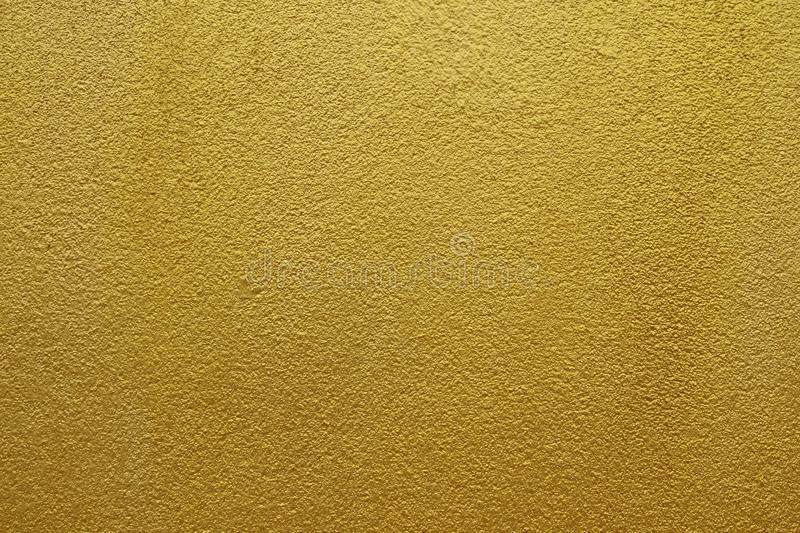 Shiny yellow leaf gold of wall texture background royalty free stock photo