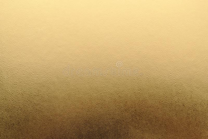 Shiny yellow metallic gold leaf foil texture background stock images
