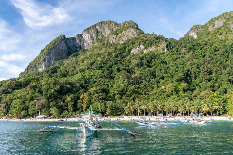 A ship anchored on the 7 commandos island beach waiting for guests in El nido, Palawan, Philippines, Nov 18,2018 A. Nov 18,2018 A ship anchored on the 7 royalty free stock photos